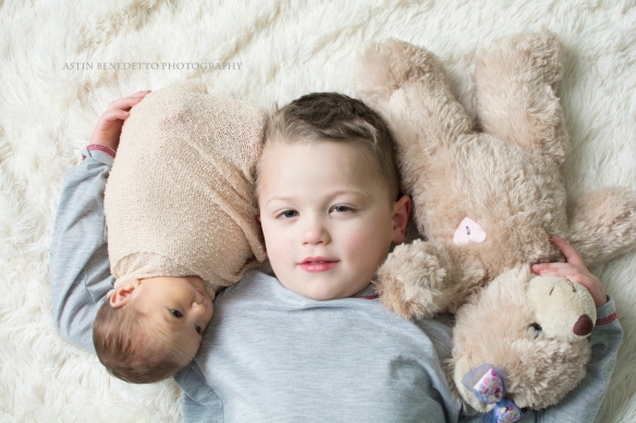 Astin-Benedetto-Photography- Warren-County-Newborn-Photographer-brother-holding-sister-molly-bear