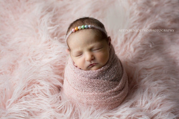 Astin-Benedetto-Photography- Warren-County-Newborn-Photographer-newborn-baby-girl-pink-wrap-potato-sack-fur