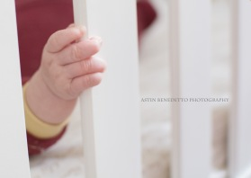 Astin Benedetto Photography-Warren County Child Photographer-baby holding crib slat